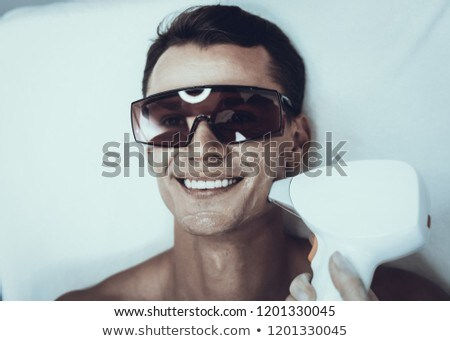 young handsome man visiting female doctor cosmetologist stock photo © elnur