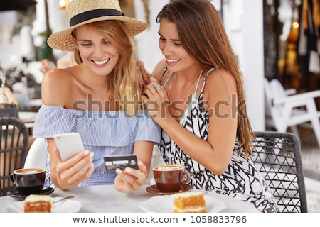 Woman buying online with credit plastic card Stock photo © Elnur
