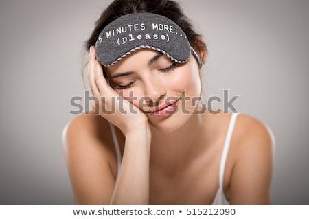 Immagine giovani assonnato donna sorridente donna Foto d'archivio © deandrobot