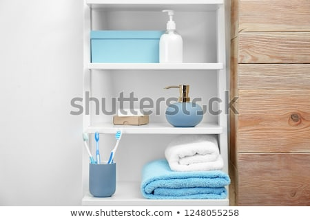 Bath accessories on shelves in bathroom  Stock photo © dashapetrenko