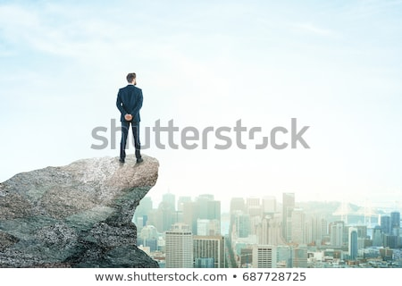Business person on the top of the rock with copy space Stock photo © ra2studio
