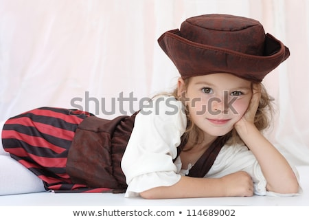 christmas portrait of a young girl dressed in red stock photo © carlodapino