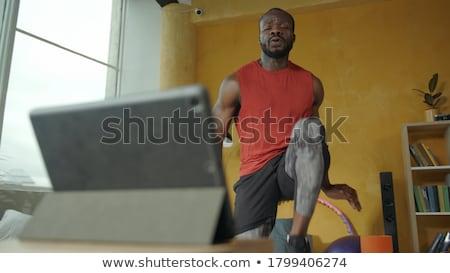 laptop with muscular biceps stock photo © ra2studio
