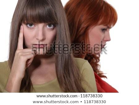 два женщину пост аргумент стороны женщины Сток-фото © photography33