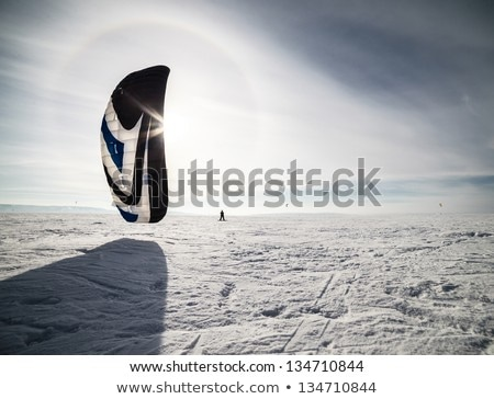 kiteboarder with blue kite on the snow stock photo © h2o