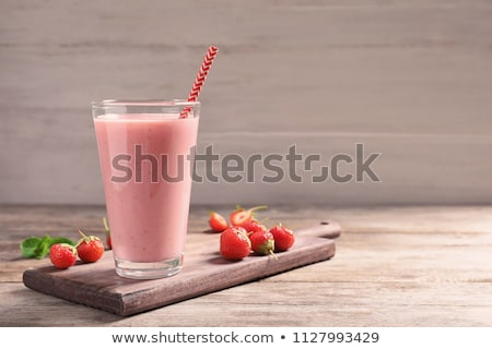 healthy strawberry smoothie with fruits on wooden background Stock photo © fotoscool