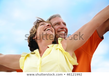Portrait Of Romantic Couple Standing With Arms Outstretched Foto stock © HannaMonika