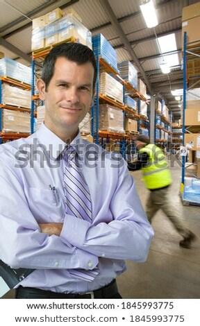 Foto stock: Empresário · em · pé · armazém · negócio