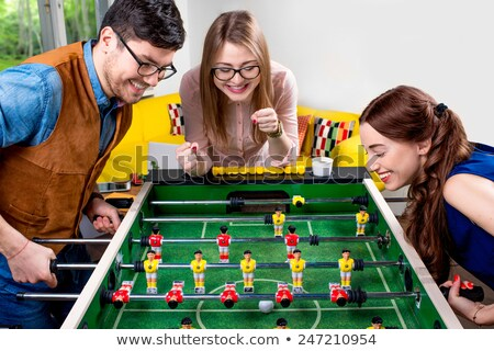 Couple having fun playing table football Stock photo © IS2