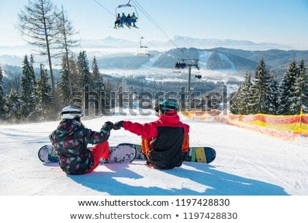 woman with skis under ski lift Stock photo © IS2
