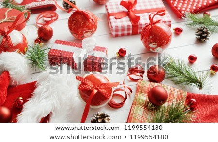 Conifer twigs and baubles near Christmas gifts Stock photo © dash