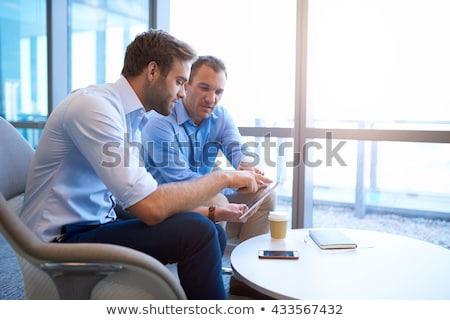 Negócio colegas comprimido escritório internet homem Foto stock © Minervastock