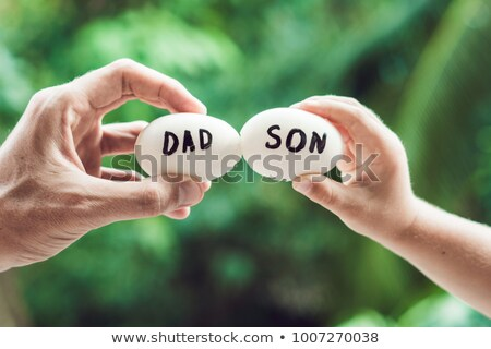 Eggs with inscriptions father and son. Problems between father and son concept Stock photo © galitskaya