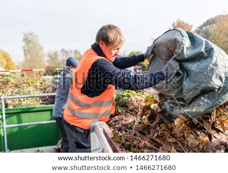 Man giving waste green in container on recycling center Stock photo © Kzenon
