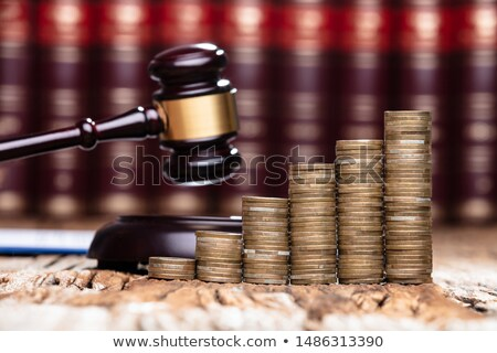 Mallet Being Hit On Stacked Coins In Courtroom Stock photo © AndreyPopov