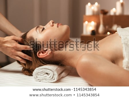 Portrait of a happy beautiful woman relaxing and revitalizing on the beach on a sunny day Stock photo © wavebreak_media
