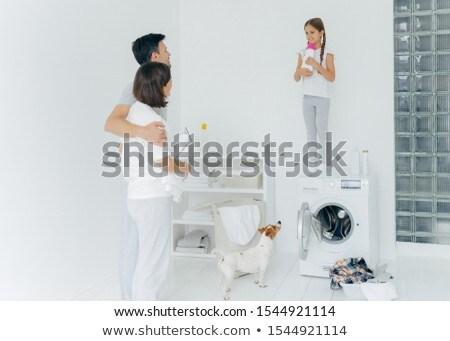 Férj feleség átölel áll szennyes szoba Stock fotó © vkstudio