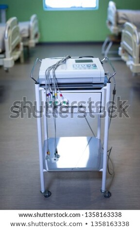 Front view of endoscopy cart machine on floor with empty beds in hospital ward Stock photo © wavebreak_media