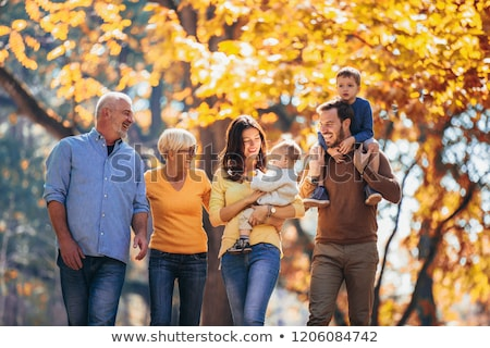 Happy family relaxing outdoors In autumn park Stock photo © Lopolo