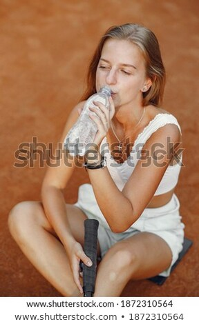 blonde sitting fitness woman opening a bottle of water stock photo © rob_stark