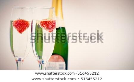 Twee champagne fluiten aardbeien fles Stockfoto © wavebreak_media