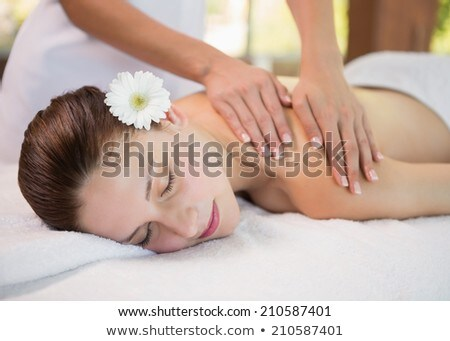 attractive young woman receiving shoulder massage stock photo © wavebreak_media