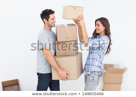 Woman giving her man a moving box  Stock photo © Kzenon