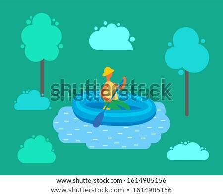 человека Hat плаванию надувной резиновые лодка Сток-фото © robuart