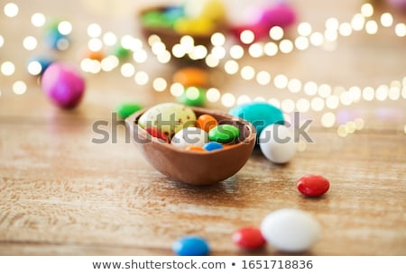 Stock photo: chocolate easter eggs and candy drops on table