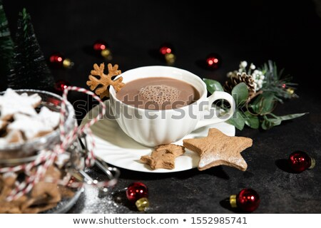 Cup of hot chocolate and Christmas shaped gingerbread cookies Stock photo © dash