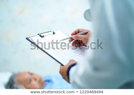 看護 ケア 寝 シニア 女性 ストックフォト © Kzenon
