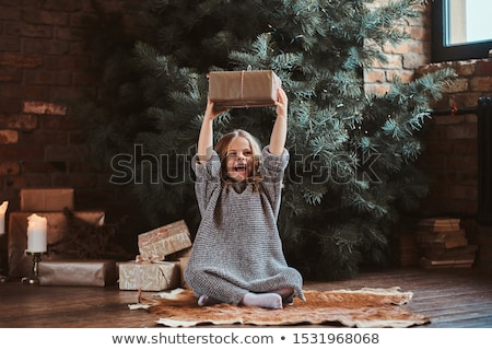 People with Presents and Gifts near Christmas Tree Stock photo © robuart