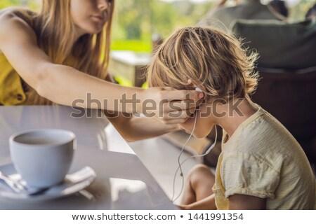 Anya fiú fejhallgató kávézó család zene Stock fotó © galitskaya