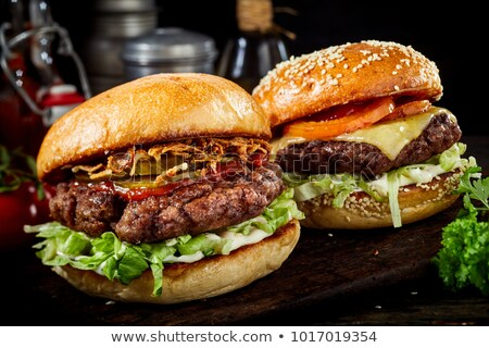 close up of hamburger and other fast food Stock photo © dolgachov