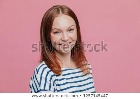 Sideways shot of pleasant looking happy brown haired woman with straight hair, healthy skin, pleasan Stock photo © vkstudio
