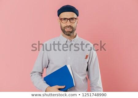 Imagem jovem masculino restolho transparente óculos Foto stock © vkstudio