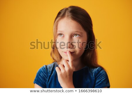 Daydreaming Little Girl Touching Mouth And Looking Up Stock photo © diego_cervo