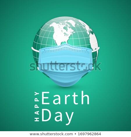 Boldog föld napja Föld földgömb orvosi arc Stock fotó © olehsvetiukha