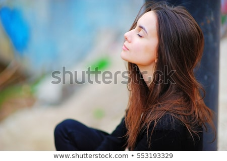Close up view of woman doing morning yoga at home, in lotus position. Stock photo © Illia