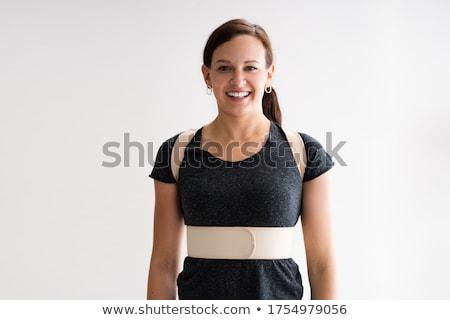 Wearing Posture Corrector Belt Or Physio Decompression Back Belt Stock photo © AndreyPopov
