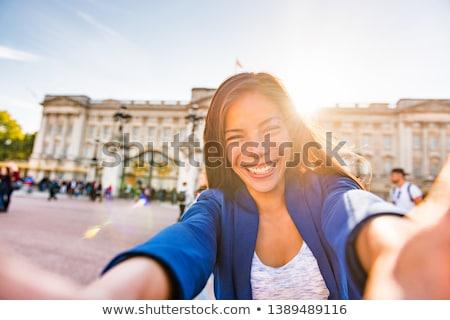 Travel selfie vlogger live streaming video online asian tourist woman social media influencer taking Stock photo © Maridav
