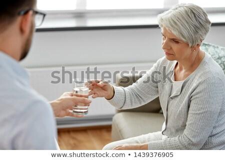 Psycholog szkła wody starszy kobieta psychologia Zdjęcia stock © dolgachov