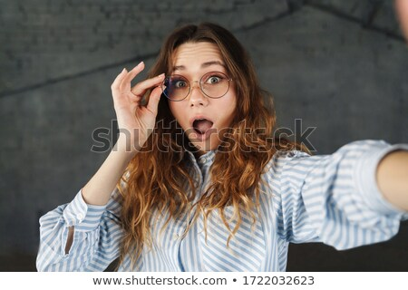 Image of excited women expressing surprise while taking selfie photo Stock photo © deandrobot