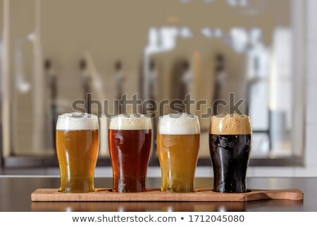 Glass of Beer on Table stock photo © jamdesign