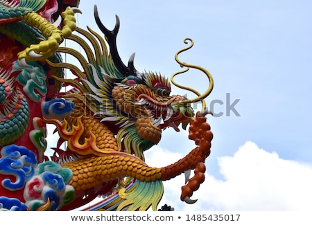golden chinese dragon and bright sky stock photo © nuttakit