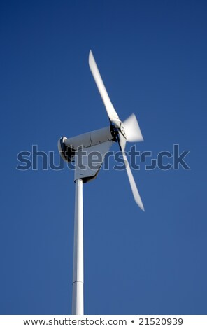 Small electricity generating wind turbine spinning with motion blur movement. Stock photo © latent