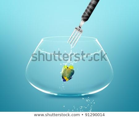 fork catch angelfish in fishbowl stock photo © designsstock