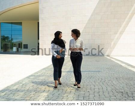 retrato · dos · empresarias · fuera · reunión · trabajo - foto stock © HASLOO