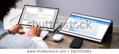 Recruiter reading job application Stock photo © photography33