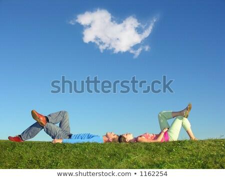 familia · hierba · cielo · azul · mentir · sonrisa · cara - foto stock © paha_l